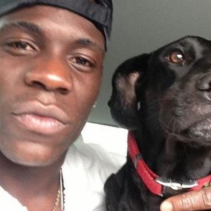Mario Balotelli with his dog.